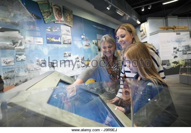 Female multi-generation family at interactive exhibit in war museum - Stock-Bilder