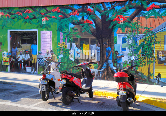 Florida Key West Florida Keys Bahamas Village Petronia Street mural Black man motor scooters parked - Stock Image