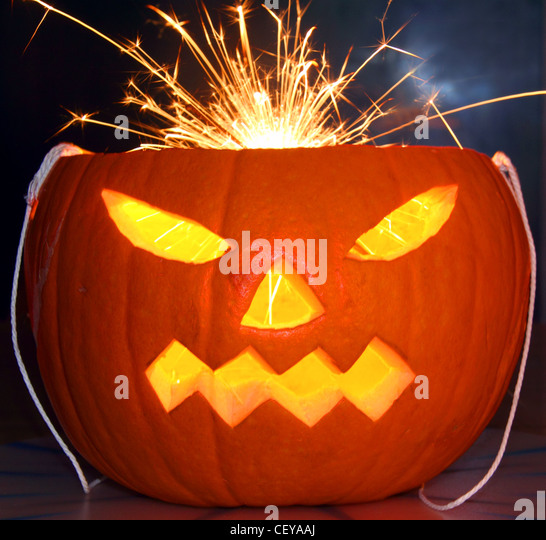 Orange Halloween Pumpkin with a sparkler for hair - Stock Image