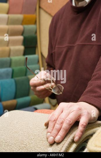 Man in a carpet shop - Stock-Bilder