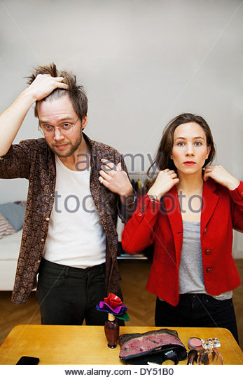 Young couple getting ready - Stock Image