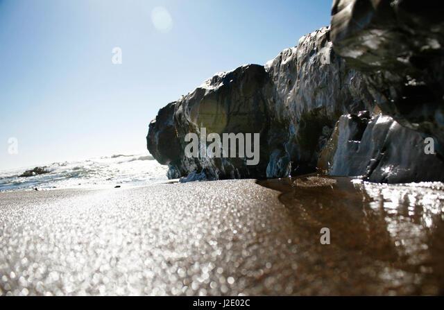 TInyBeachCliff382521126   - Stock Image
