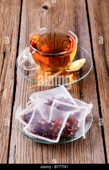 Cup of tea and nylon tea bags - Stock Image