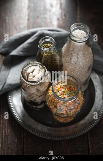 White beans, green beans, lentils and rice banks vertical - Stock Image