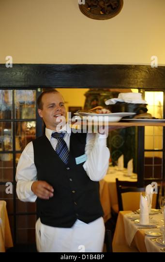 Karlovy Vary, Czech Republic, a waiter at the restaurant of the Embassy - Stock-Bilder
