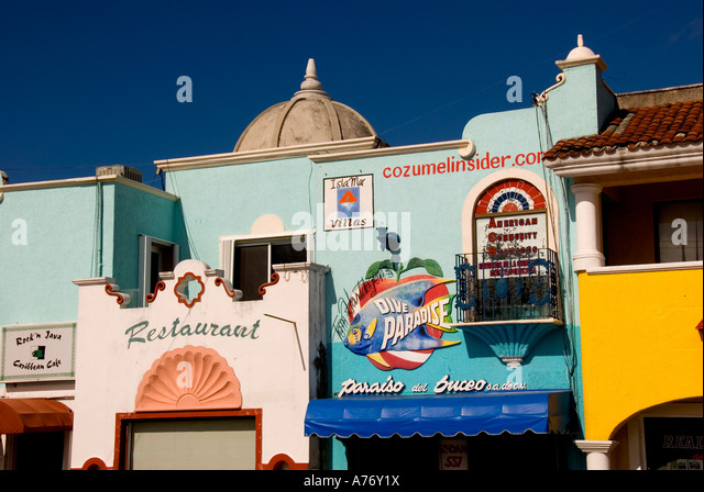 Cozumel Mexico San Miguel town skyline bright yellow pink and blue colorful buildings - Stock Image