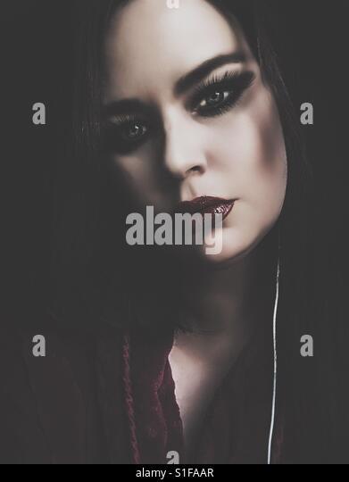 Somber portrait of young woman - Stock-Bilder