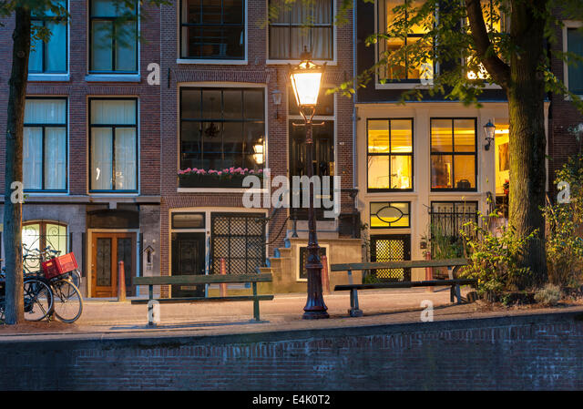 Amsterdam Canal night.  Leidsegracht Canal Amsterdam with popular canal-side bench from film The Fault in Our Stars - Stock Image