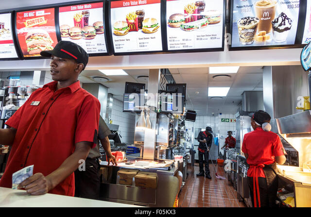 Cape Town South Africa African V & A Victoria Alfred Waterfront McDonald's restaurant fast food inside menu - Stock Image