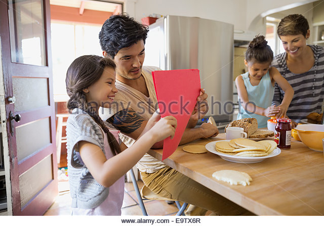 Family enjoying breakfast in kitchen - Stock Image