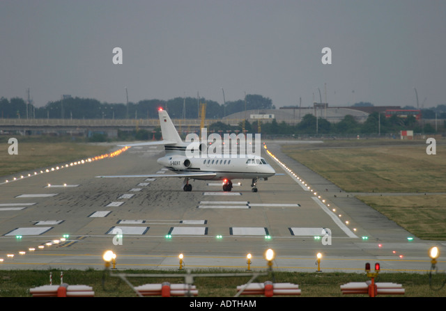 Corporate jet on runway - Stock Image