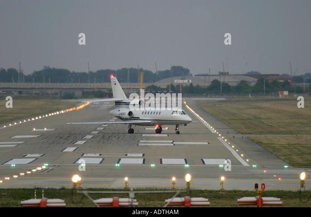 Corporate jet on runway - Stock Image