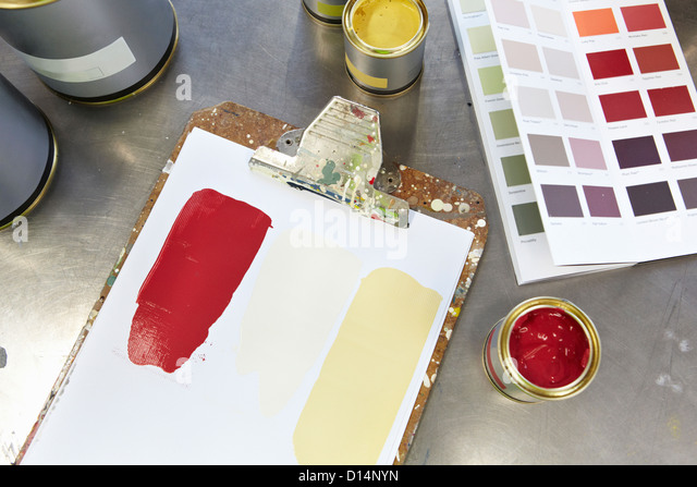 Paint cans, swatches and clipboard - Stock Image