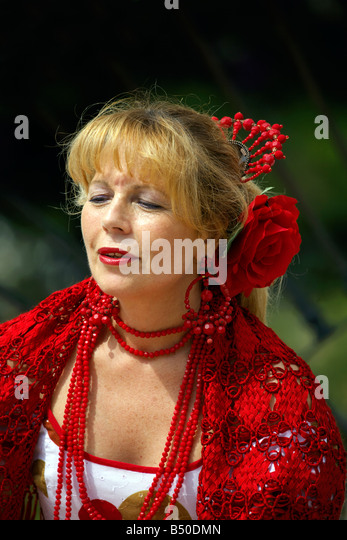 Beautiful blond middle aged Spanish woman in traditional costume, Andalucia, Spain, Europe - Stock Image