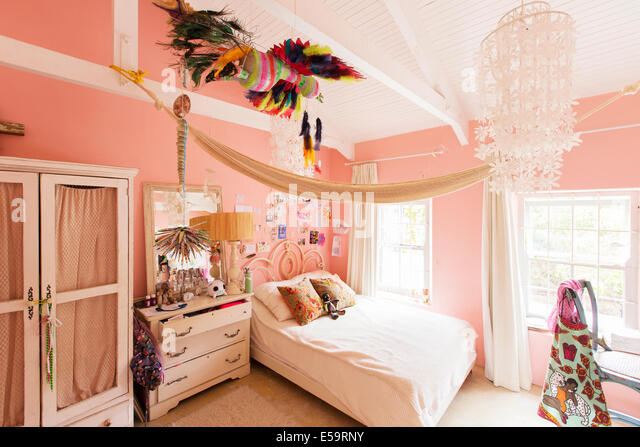 Decorations in bedroom of rustic house - Stock Image