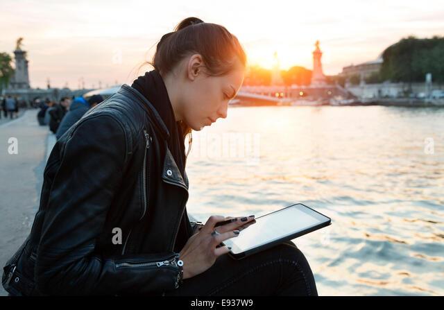 Woman using Digital Tablet - Stock Image