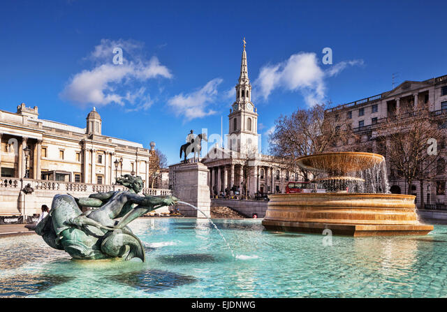 Trafalgar Square, London, with the Church of St Martin in the Fields, and the statue of George IV. - Stock Image