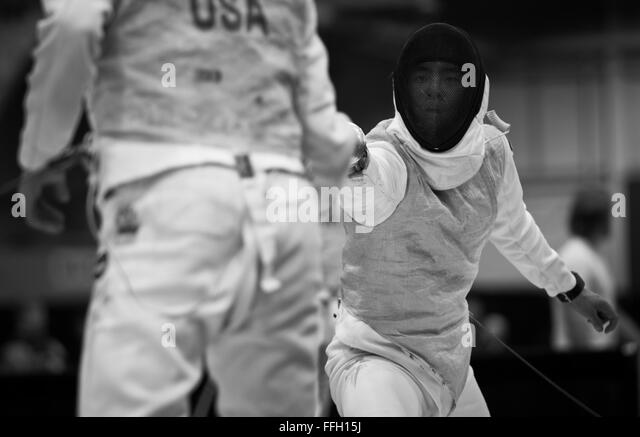 Alexander Chiang reaches out and attempts to score on his opponent. The foil is used as a thrusting weapon only. - Stock Image