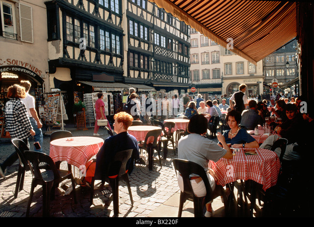 Alsace cafe framework France Europe half timbered houses no model release old town passerby pedestrian prec - Stock Image