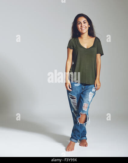 Full length portrait of a woman in jeans and a shirt. Isolated portrait - Stock Image