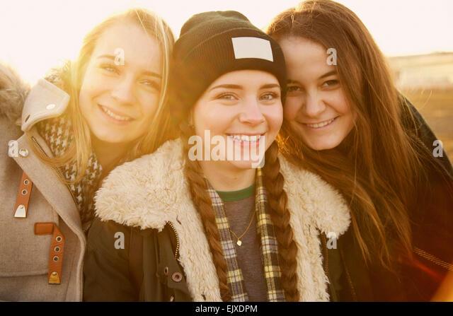 Portrait of Three Teenage Girls Smiling - Stock Image