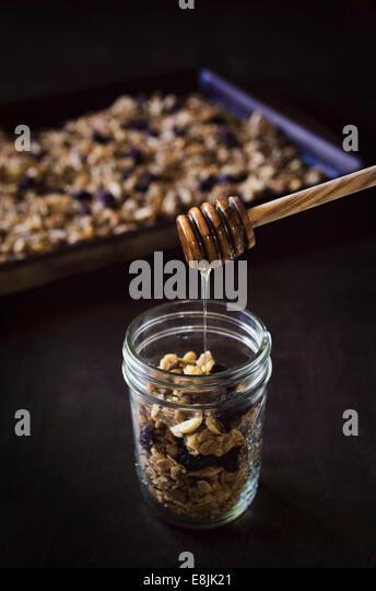 Granola in a jar. - Stock Image