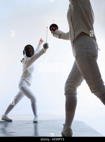 two people fencing - Stock Image