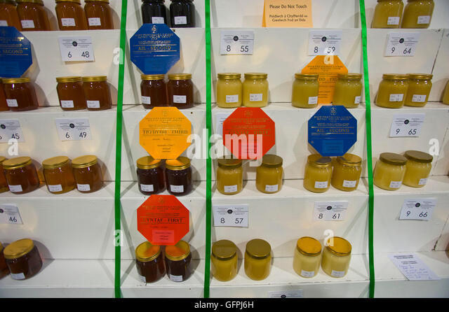 Prizewinning honey in the Food Hall at the Royal Welsh Show, Royal Welsh Showground, Llanelwedd, Builth Wells, Powys, - Stock Image