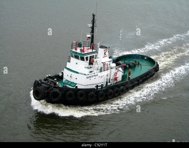 Montevideo, Montevideo, Uruguay Tug boat escorting ship with pilot on board. - Stock Image
