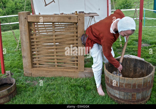 Demonstration of Medieval house building techniques -Mixing the Daub - Stock Image