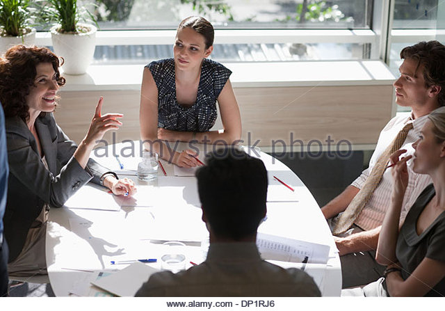 Business people meeting in sunny conference room - Stock Image