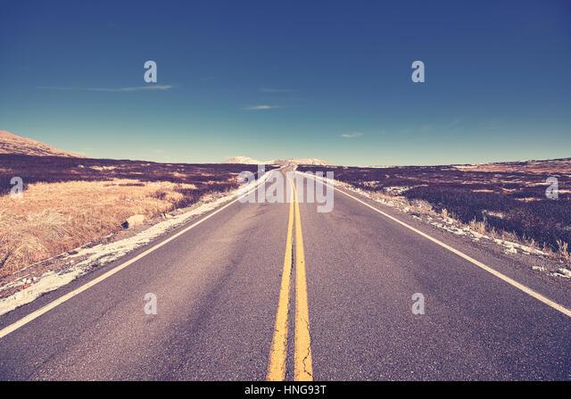 Color toned mountain asphalt road, travel concept. - Stock-Bilder