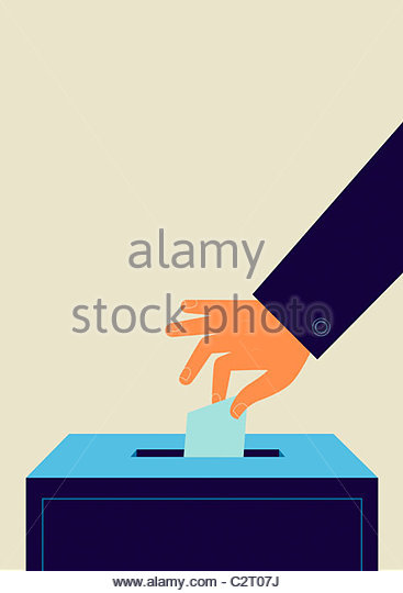 Hand putting ballot into ballot box - Stock Image