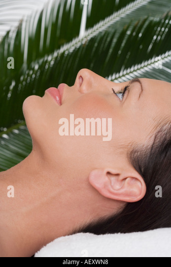 Woman lying on her back at spa - Stock Image