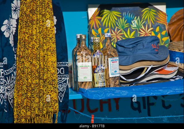 mama juana brugal rum hats and dresses at small gift shop at Bayahibe fishing village Dominican Republic southeast - Stock Image