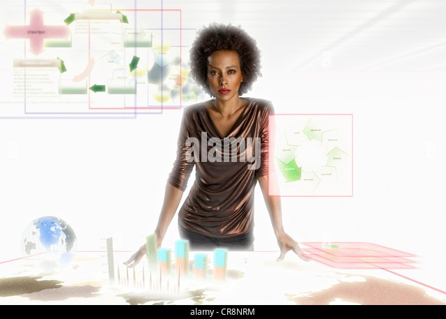 Businesswoman surrounded by holographic objects - Stock Image
