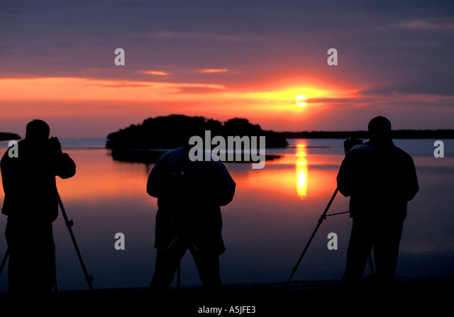 Florida Everglades National Park photographers capturing sunrise over mangrove island - Stock Image
