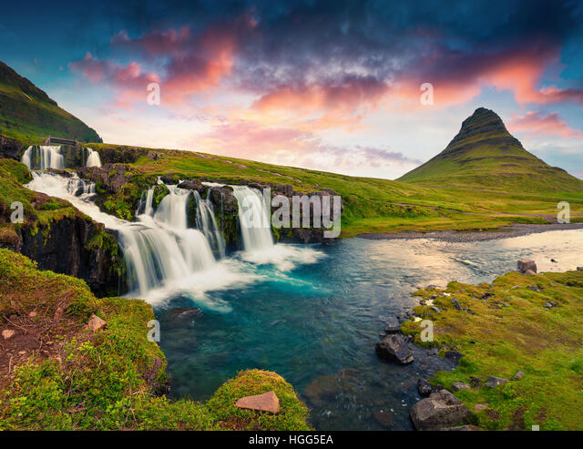 Summer sunset on famous Kirkjufellsfoss Waterfall and Kirkjufell mountain. Colorful evening scene on Snaefellsnes - Stock Image