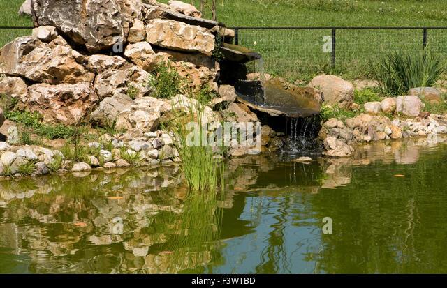 Garden landscape design little pond stock photos garden for Artificial waterfalls design