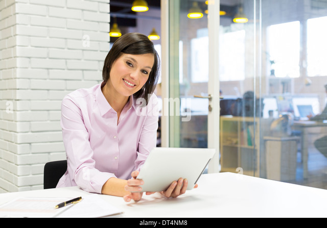 Female pc tablet desk e-mail - Stock Image