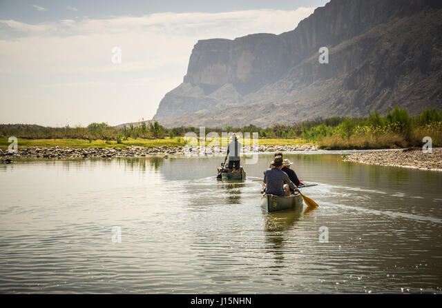 Canoeing down the Rio Grande river just down stream from Santa Elena canyon, Big Bend National Park, Texas. - Stock Image