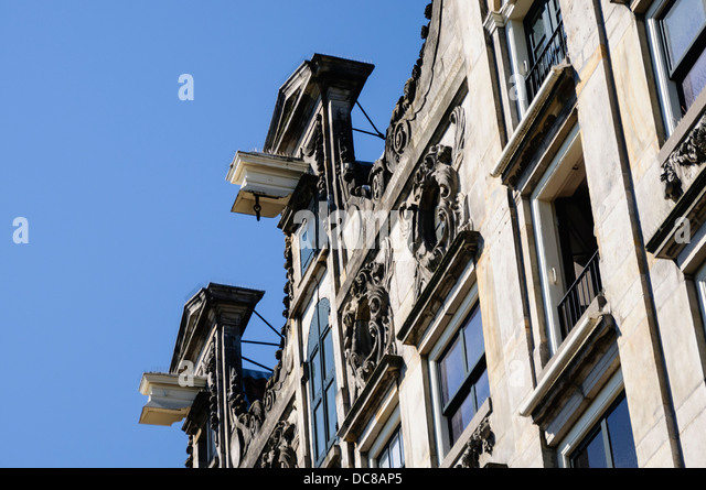 Hooks on the roof of an ornate house in Amsterdam - Stock Image