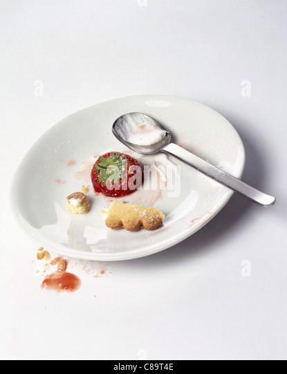 Remains of dessert on plate - Stock Image