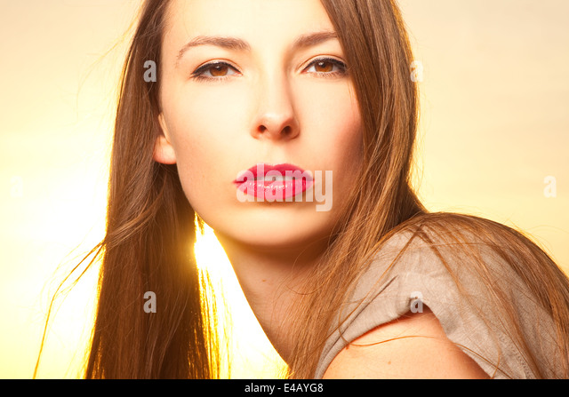 Beautiful, happy young woman in sunlight - Stock Image
