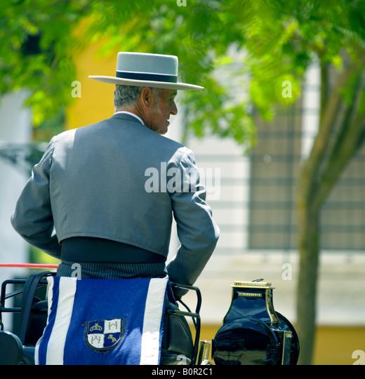 Carriage driver in traditional costume, Jerez de la Frontera, Andalucia, Spain - Stock Image