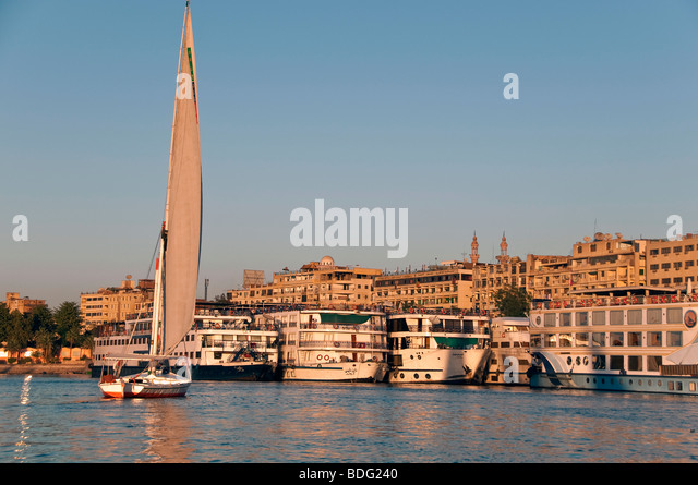Felucca Nile River Aswan Egypt traditional wooden sailboat with lateen sail used used for transportation - Stock Image