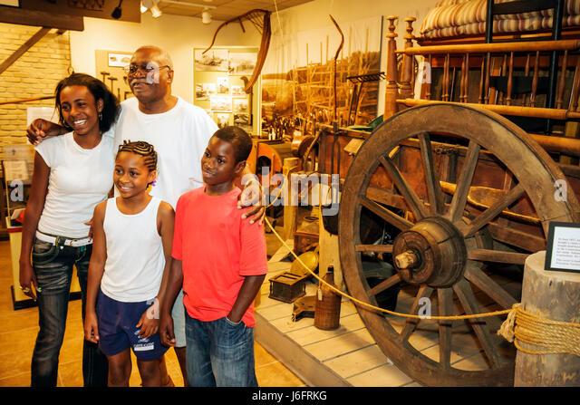 Wisconsin Kenosha Simmons Island Kenosha History Center Yesteryear Gallery Black man girl boy teen father. child - Stock Image