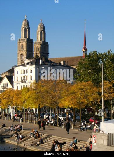 Switzerland Zuerich Promenade Limmat Grossmuentser kathedral Zuerich Grossmuenster Promande an der Limmat im Herbst - Stock Image