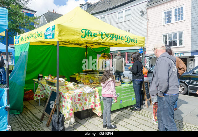 Food sellers at the Totnes Good Food Market which operates on the third sunday of each month - Stock Image