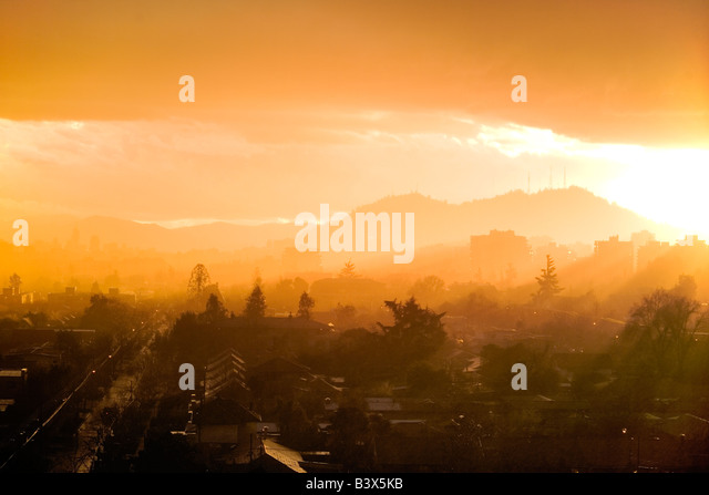 Sunset in Santiago de Chile in a rainy day - Stock Image